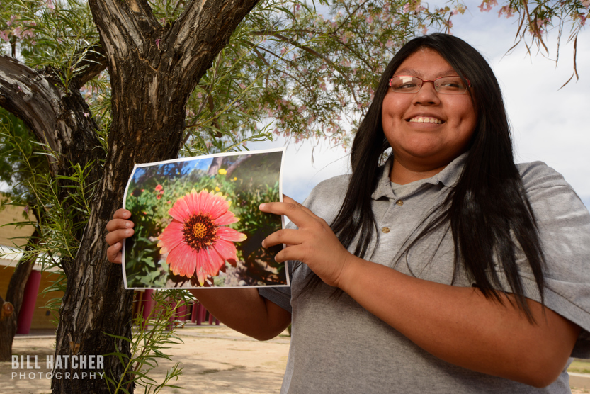 Photo by Bill Hatcher (Instagram: @bhatcherphoto). A girl of the Tohono O'odham Nation in Sells, Arizona, shows a photograph of local flora.