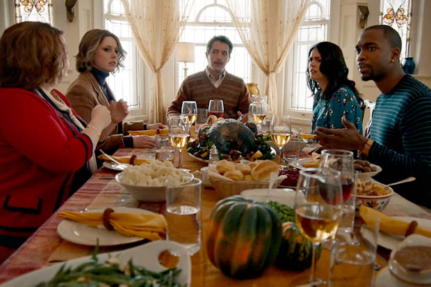 Image of Saturday Night Live comedians at the dinner table for a holiday meal